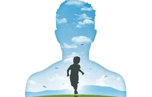 silhouette of a young man's portrait showing his inner child living in his mind